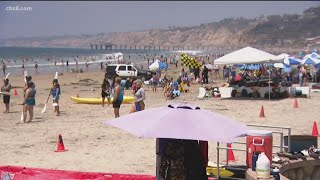 Large crowds fill San Diego County beaches as holiday weekend begins