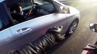 Biker punches a car's mirror for absolutely no reason [READ THE #