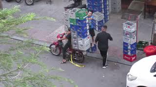 VIETNAM: SAIGON:  BEER DISTRIBUTION BY MOTOBIKE