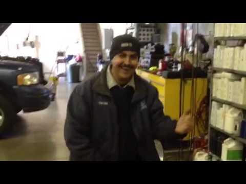 Mexican mechanic dancing on the job