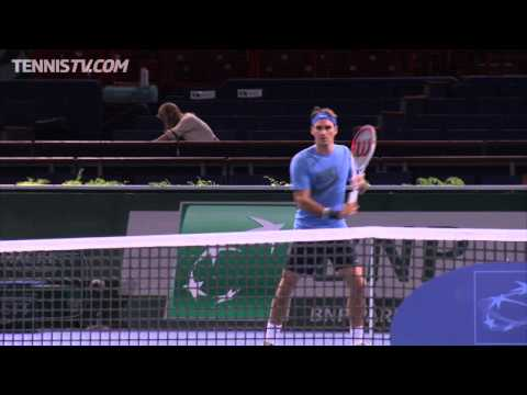 Roger Federer takes to the practice court in Paris