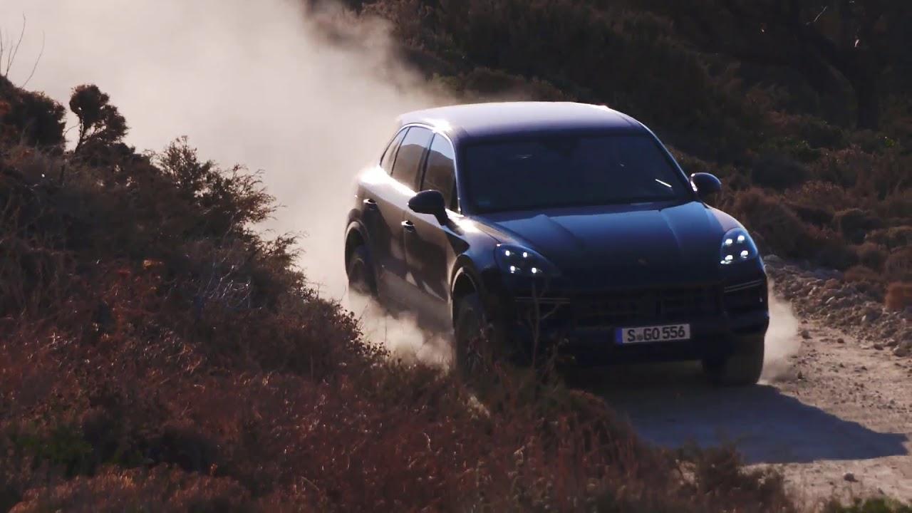 Porsche Cayenne Turbo Driving Off Road In Moonlight Blue Metallic
