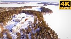 FINLAND Above Punkaharju  Kruunupuisto 4K Birds Eye view  Winter