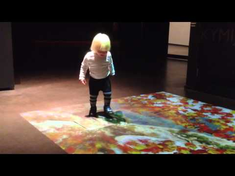 Child playing with interactive floor game, Maritime Centre Vellamo, Kotka