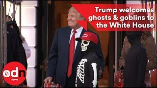 2017-10-31-15-05.Trump-welcomes-ghosts-goblins-to-the-White-House