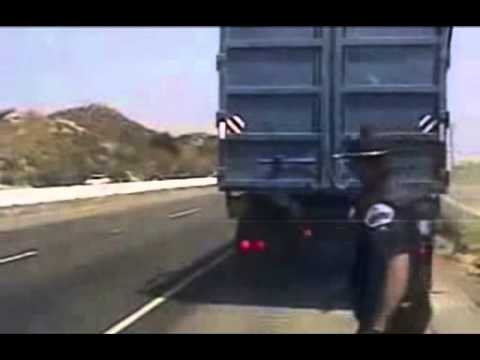 Police Officer Pulls Over An 18-Wheeler And Almost Gets Taken Out By A Small Truck