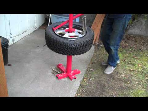 Mounting a rally tire with a harbor freight manual tire changer.