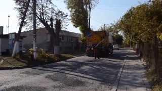 Ремонт дороги на вулиці Ак. Павлова у Золочеві, 11 жовтня 2014 року
