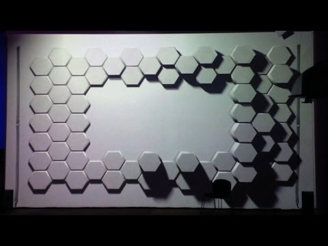 Hexagons 3D projection mapping experiment on wall with hexagonal tiles.