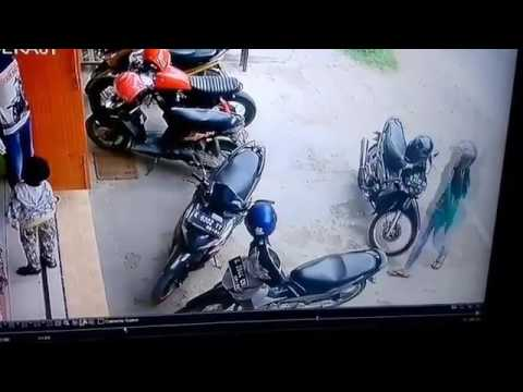 Girl Tries to Get Motorcycle Out of Parking Space