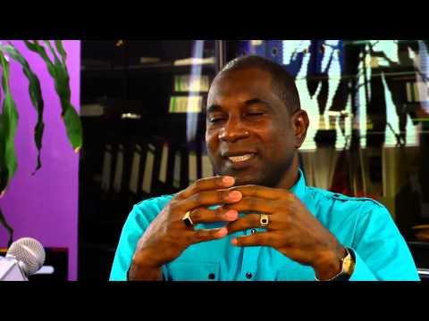 LIME Dominica's General Manager Jeffrey Baptiste speaks on the 11th Annual Creole in the Park
