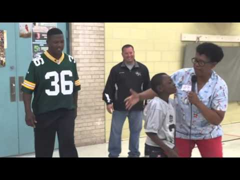 Green Bay Packer LeRoy Butler surprises student
