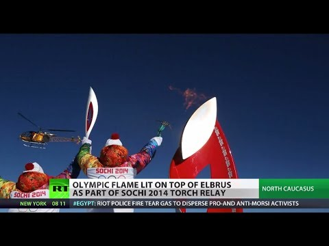 Mountain High: Olympic flame reaches Europe's tallest peak