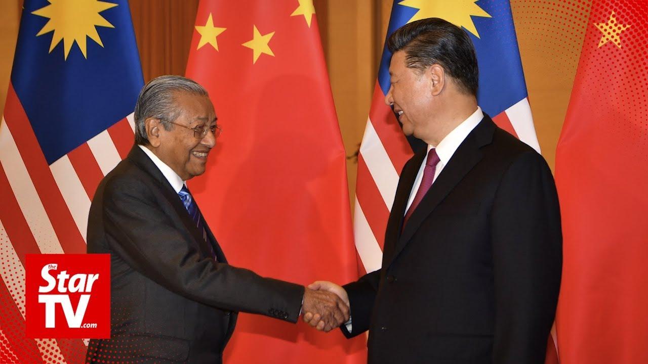 President Xi, Premier Li meet Tun M
