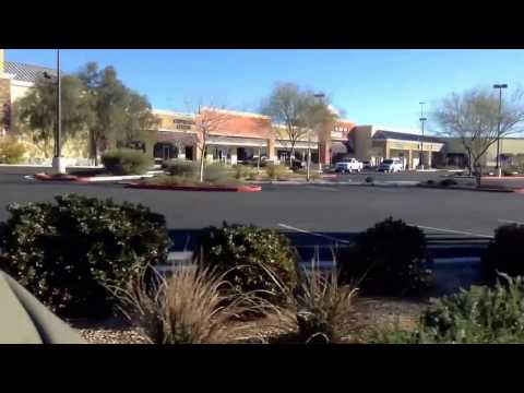 Bicycling and looking at Centennial Hills business; Las Vegas, Nevada
