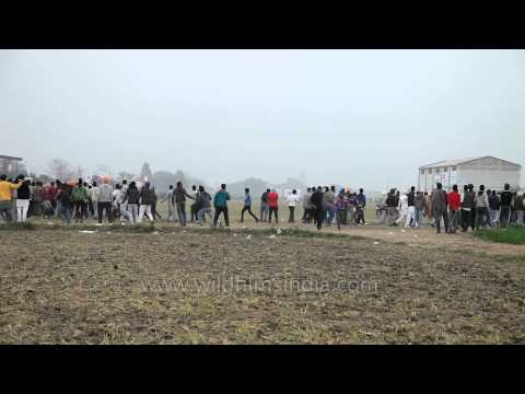 Indian villagers taking part at horse race