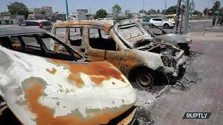 Residents accuse each other of burning cars following night of clashes in Lod