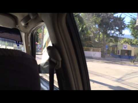 Taking a street taxi in downtown San Pedro Sula