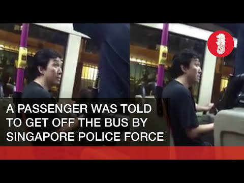Singapore Policemen Asking A Passenger To Get Off The Bus