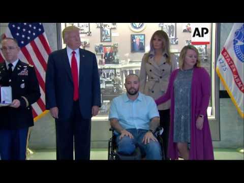 Trump awards Purple Heart at military hospital