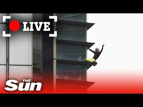 French spiderman free climbs one of Paris' tallest buildings LIVE