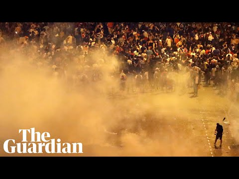 Police and football fans clash in Paris after France's World Cup victory