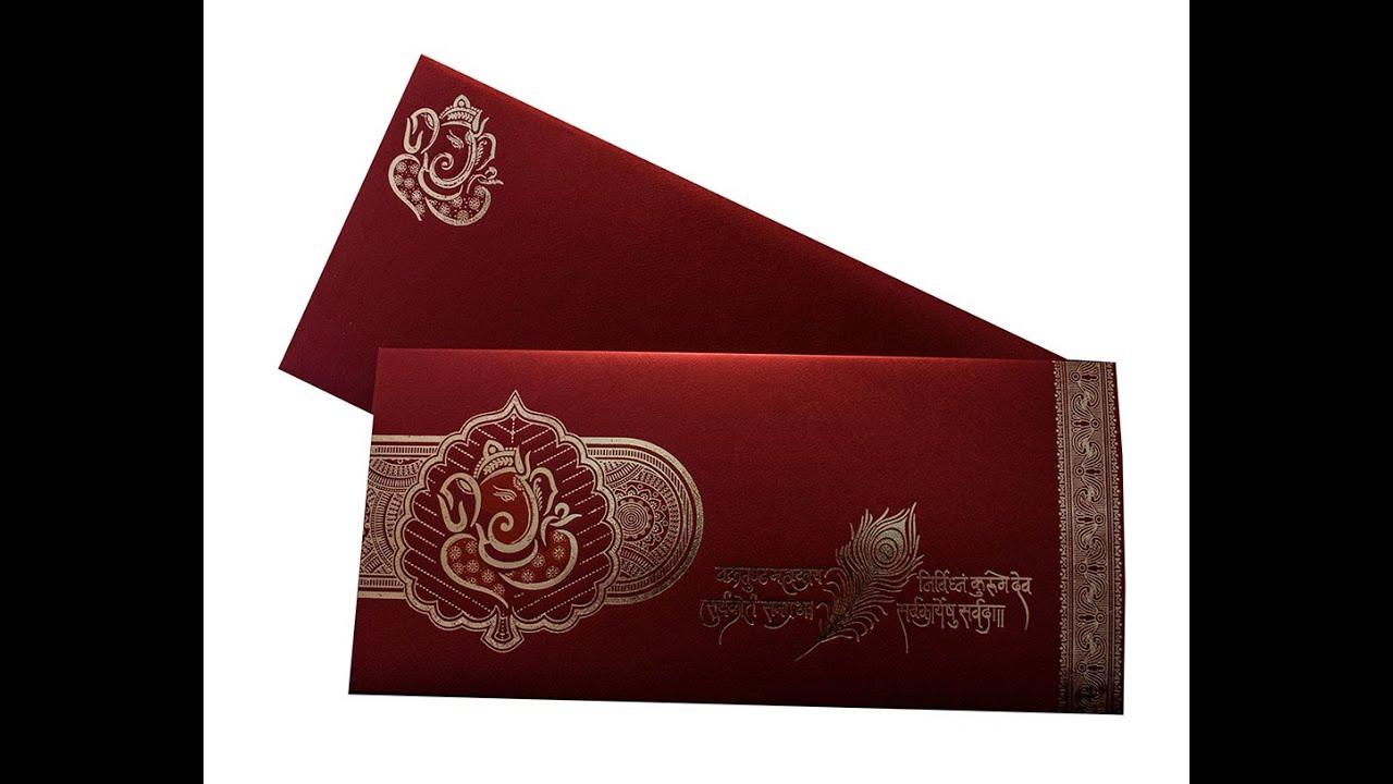 ganesha theme hindu wedding card in maroon color  amb1542