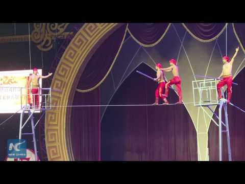 Stunts on tightrope: Fascinating acrobatic show staged in C China
