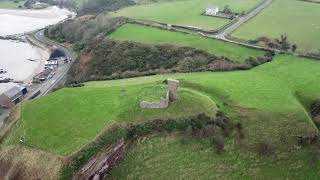 Aerial view and zoom out of Redbay Castle Ruins, Co.Antrim, N.Ireland filmed with DJI Mavic Pro