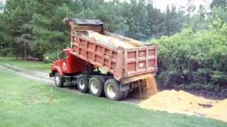 Spreading Sand with the dump truck