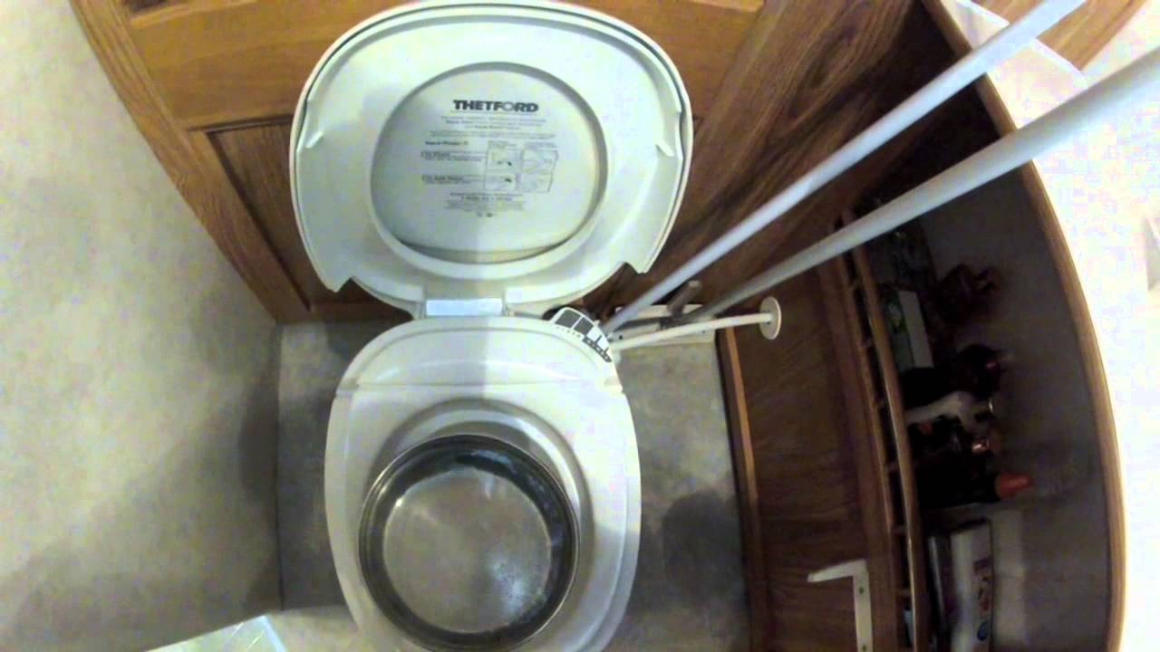 Unclogging the RV toilet - YouTube