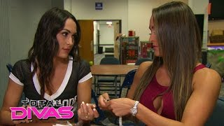 The Bella Twins argue at the merchandise table: Total Divas, January 11, 2015