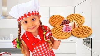 Diana cozinha com brinquedos de cozinha bonitinhos