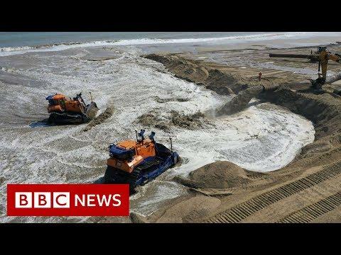 Huge sand dune to protect major UK gas terminal - BBC News