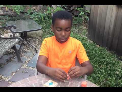 Dissecting a Playdough Rhombic Dodecahedron with Miles