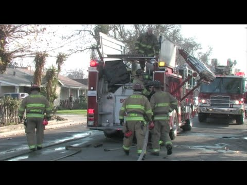 Fire Threatens A Duplex - Firefighters Save Homes In Modesto, California