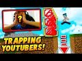 INVISIBLE WALL TRAPPING YOUTUBERS! - Minecraft SKYWARS TROLLING (HE RAGED!)