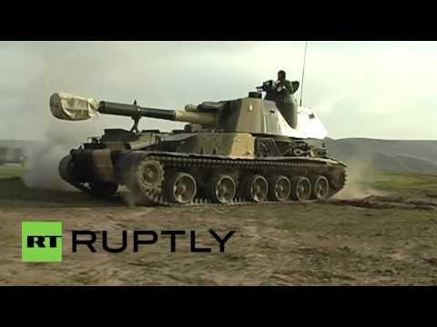 Tajikistan: Russian 2S3 Akatsiya artillery units carry out live fire drills