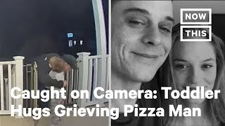 Watch This Toddler Give a Grieving Father a Surprise Hug | NowThis