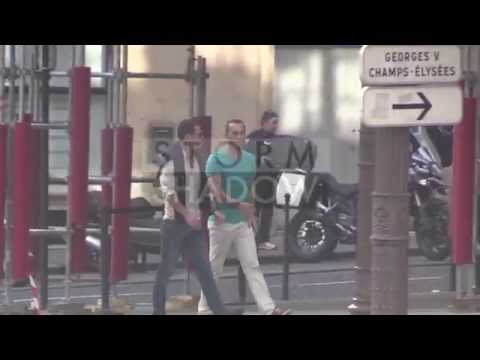 Luke Evans taking a walk on the Champs Elysees with a male friend