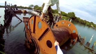 Climbing over a wrecked cable laying boat