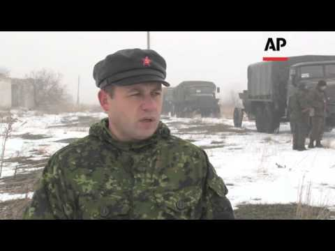 Rebel column in Donetsk while in Luhansk  forces withdraw weaponry as per truce