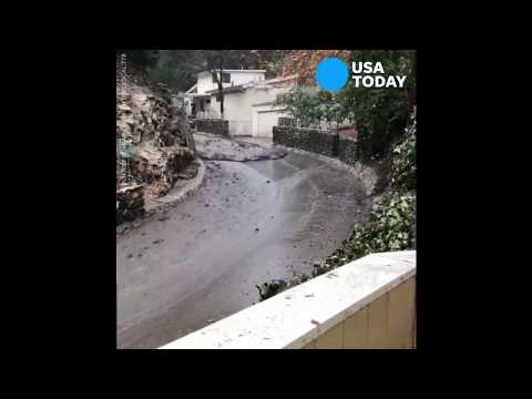 Prius slides down hill propelled by California mudslide