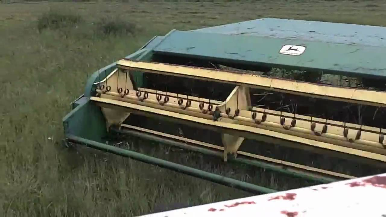 Cutting hay with my John Deere 1209 - YouTube