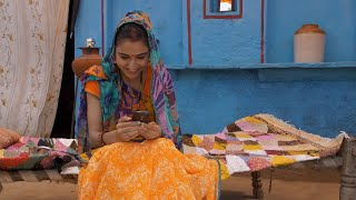 Beautiful village woman texting on a smartphone and giving different reactions
