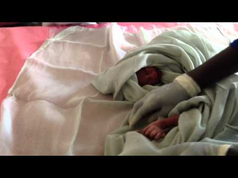 Grandmothers sing about the birth of twin girls in Kuajok, South Sudan