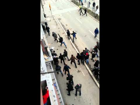 Assaulting police protest in Kosovo