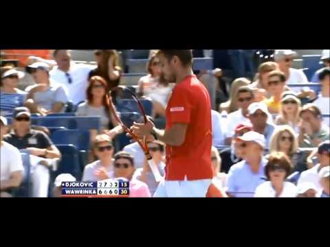 Stanislas Wawrinka breaks his racket into pieces during his US Open semi-final with Novak Djokovic