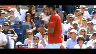 Stanislas Wawrinka breaks his racket into pieces during his US Open semi-final with Novak Djokovic