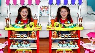 Masha and Vania play with ice cream shoop